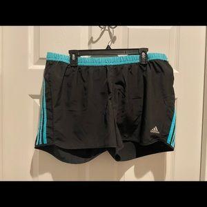 Adidas: Black and blue running shorts